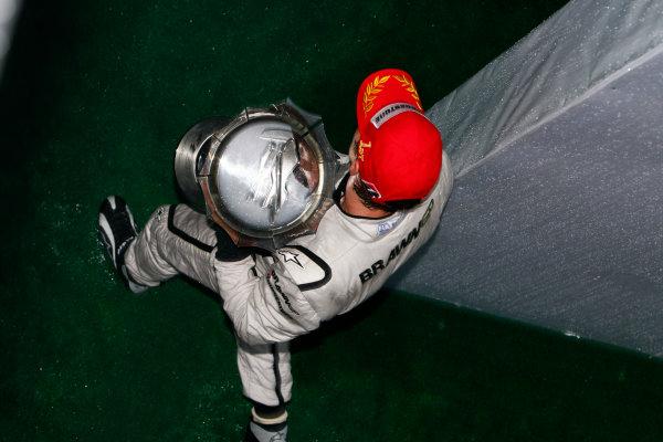 Sepang, Kuala Lumpur, Malaysia5th April 2009Jenson Button, Brawn GP BGP001 Mercedes, 1st position, celebrates on the podium. Portrait. Podium. World Copyright: Steven Tee/LAT Photographicref: Digital Image _95U0218