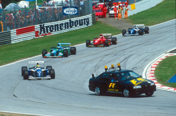 Imola, Italy.29/4-1/5 1994.Ayrton Senna (Williams FW16 Renault) leads the rest of the field behind the safety car which was brought out after the Lehto/Lamy startline shunt.Ref-94 SM 20.World Copyright - LAT Photographic