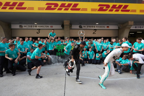 Shanghai International Circuit, Shanghai, China. Sunday 12 April 2015. Lewis Hamilton, Mercedes AMG, 1st Position, and Nico Rosberg, Mercedes AMG, 2nd Position, celebrate another victory with their team mates. World Copyright: Steve Etherington/LAT Photographic. ref: Digital Image SNE11419