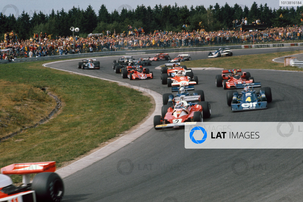 Nurburgring, Germany. 1st August 1976.Clay Regazzon (Ferrari 312T2), 9th position, leads Jody Scheckter (Tyrrell P34-Ford), 2nd position, Patrick Depallier (Tyrrell P34-Ford), retired, Jochen Mass (McLaren M23-Ford), 3rd position and Carlos Pace (Brabham BT45-Alfa Romeo), 4th position, at the start, action. World Copyright: LAT PhotographicRef: 76GER