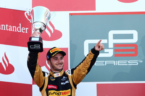 2012 GP3 Series, Round 3.Valencia, Spain. 24th June 2012. Sunday Race 2. Daniel Abt (GER, Lotus GP) celebrates on the podium. Portrait. World Copyright:  Daniel Kalisz/LAT Photographic Ref: Digital Image IMG_2115
