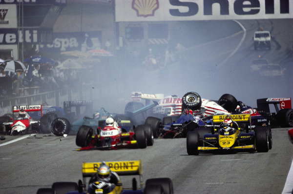 Crash at the second start with Pascal Fabre, AGS JH22 Ford, ending up on top of Ivan Capelli's March 871 Ford, and Martin Brundle, Zakspeed 871, Piercarlo Ghinzani, Ligier JS29C Megatron, and Stefan Johansson, McLaren MP4-3 TAG, also suffering damage.