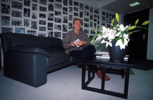 Mika Hakkinen (FIN) with pictures of his achievements on his wall.