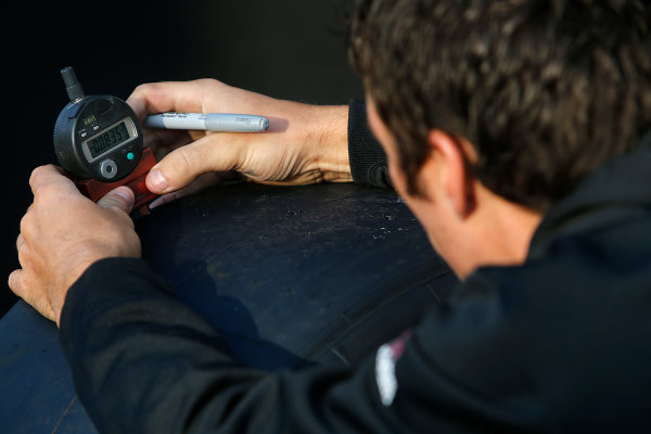 15-17 August, 2014, Brooklyn, Michigan USA Crewman checking tires ©2014, Brett Moist LAT Photo USA