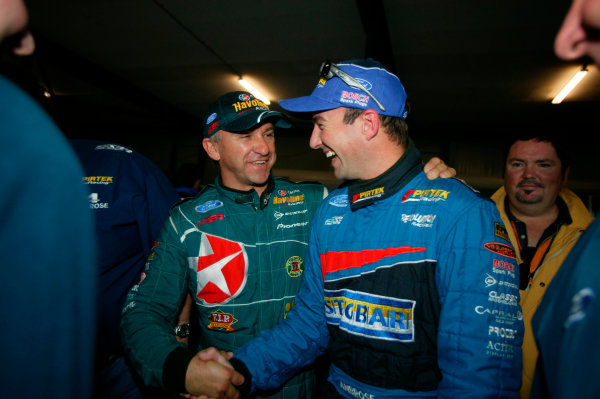 2003 Australian V8 SupercarsOran Park, Sydney, Australia. 17th August 2003.Ford driver Marcos Ambrose is congratulated by team mate Russell Ingall after taking pole for the 300km race at Sydneys Oran Park. World Copyright: Mark Horsburgh/LAT Photographicref: Digital Image Only