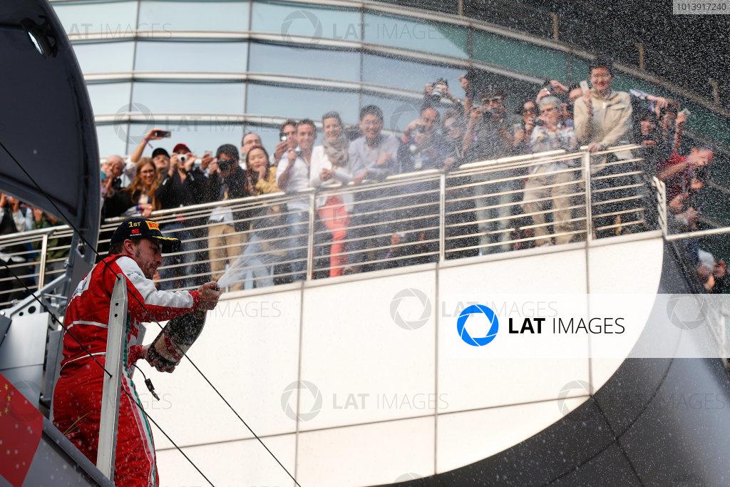 Shanghai International Circuit, Shanghai, China Sunday 14th April 2013 Fernando Alonso, Ferrari. celebrates on the podium World Copyright: Charles Coates/LAT Photographic ref: Digital Image _N7T7495