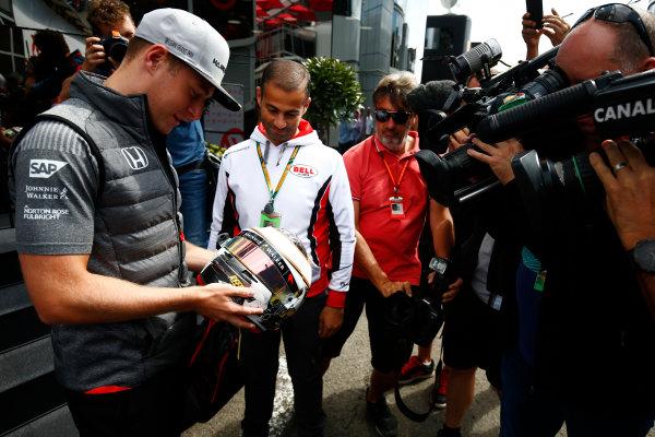 Spa Francorchamps, Belgium.  Thursday 24 August 2017. Stoffel Vandoorne, McLaren, examines a helmet in front of media. World Copyright: Andy Hone/LAT Images  ref: Digital Image _ONZ8208
