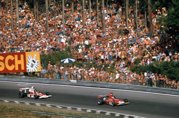 1974 Austrian Grand Prix  Osterreichring, Austria. 16-18th August 1974.  Clay Regazzoni, Ferrari 312B3, 5th position, leads Emerson Fittipaldi, McLaren M23 Ford, retired, at the Bosch Kurve.  Ref: 74AUT06. World Copyright: LAT Photographic