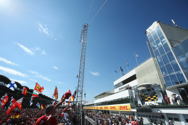 Hungaroring, Budapest, Hungary.  Sunday 30 July 2017. Ferrari fans celebrate after the race as Sebastian Vettel, Ferrari, 1st Position, arrives on the podium. World Copyright: Coates/LAT Images  ref: Digital Image AN7T9895
