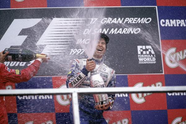 Heinz-Harald Frentzen celebrates his first Grand Prix win on the podium.
