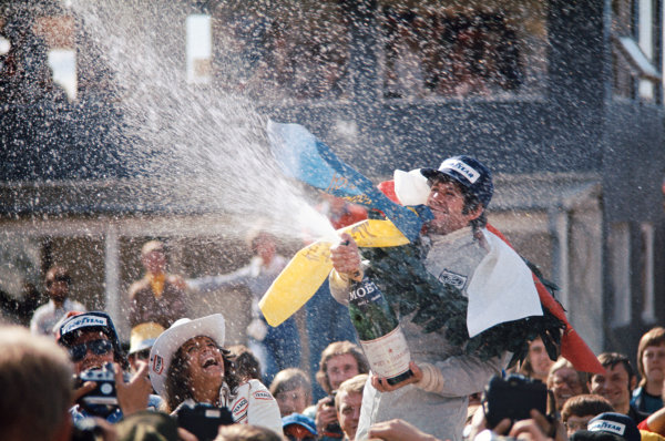 1974 Swedish Grand Prix  Anderstorp, Sweden. 7-9 June 1974.  Jody Scheckter, Tyrrell, 1st position, celebrates on the podium.  Ref: 74SWE04. World Copyright: LAT Photographic