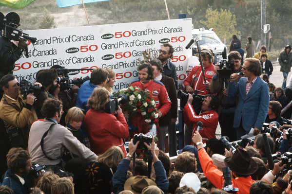 1974 Canadian Grand Prix. Mosport Park, Ontario, Canada. 20th - 22nd September 1974. Emerson Fittipaldi (McLaren M23 Ford) ,1st position, podium, portrait. World Copyright: LAT Photographic.  Ref:  74CAN09.