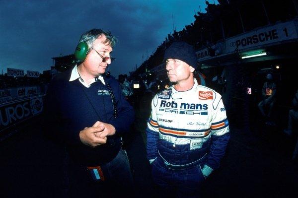 (L to R): Norbert Singer (GER) Porsche Designer and Bob Wollek (FRA). Le Mans 24 Hours, Le Mans, France, 15 - 16 June 1985.