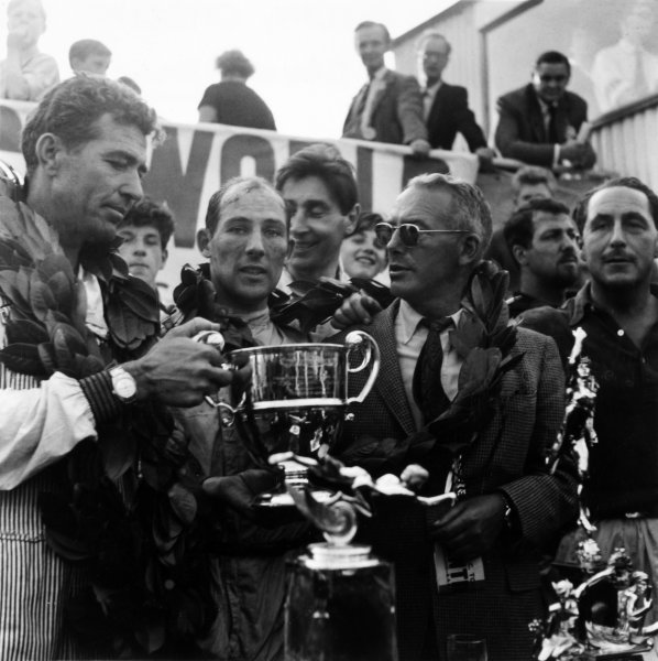 1959 Tourist Trophy.Goodwood, West Sussex, Great Britain. 5th  September 1959.The winning Aston Martin team left-to-right: Carroll Shelby, Stirling Moss, Roy Salvadori, David Brown and Jack Fairman on the podium, portrait.World Copyright: LAT PhotographicRef: 5037.
