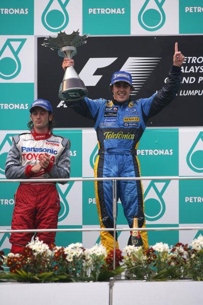 2005 Malaysian Grand Prix - Sunday Race, Sepang, Kuala Lumpur. Malaysia. 20th March 2005 Race podium - winner Fernando Alonso, Renault R25 (1st) and Jarno Trulli, Toyota TF105 (2nd).World Copyright: Steve Etherington/LAT Photographic ref: 48mb Hi Res Digital Image Only