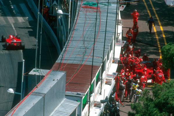 Monte Carlo, Monaco. 29th May 2001. Michael Schumacher pits his Ferrari F2001 as Rubens Barrichello races around the harbour complex.World Copyright: Michael Cooper/LAT Photographic ref: 35mm Priority Image 01MON01