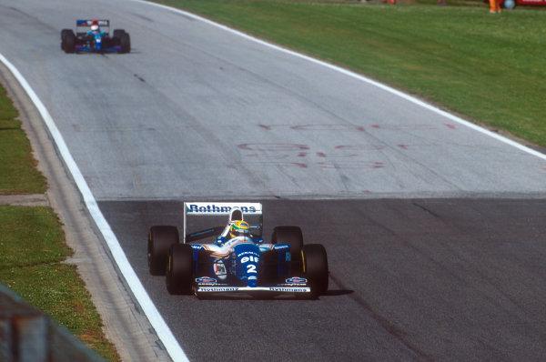 Imola, Italy.29/4-1/5 1994.Ayrton Senna (Williams FW16 Renault) followed by Roland Ratzenberger (Simtek S941 Ford) who were both tradgically killed at Imola.Ref-94 SM 21.World Copyright - LAT Photographic