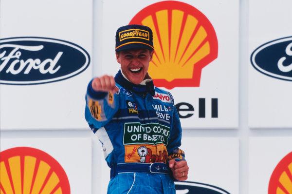 Interlagos, Sao Paulo, Brazil.25-27 March 1994.Michael Schumacher (Benetton Ford) celebrates his win on the podium. Ref-94 BRA 09.World Copyright - LAT Photographic