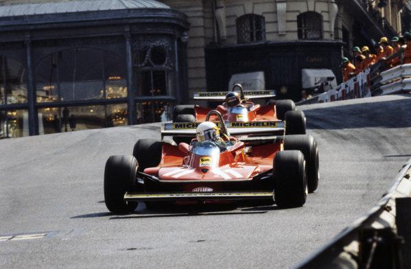 Jody Scheckter, Ferrari 312T4 leads Gilles Villeneuve, Ferrari 312T4.