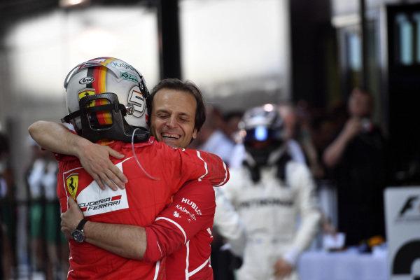 Race winner Sebastian Vettel (GER) Ferrari celebrates in parc ferme with Fraboni (ITA) Ferrari Head of Engine Trackside Operations at Formula One World Championship, Rd1, Australian Grand Prix, Race, Albert Park, Melbourne, Australia, Sunday 26 March 2017.