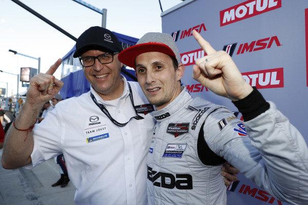 Motul Pole Award winner #77 Mazda Team Joest Mazda DPi, DPi: Oliver Jarvis with Mazda Director of Motorsports John Doonan