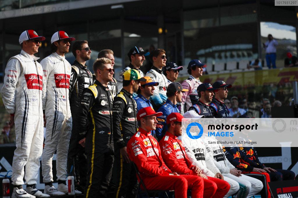 The class of 2019 pose for a final group photo. Back row L-R: Kimi Raikkonen, Alfa Romeo Racing, Antonio Giovinazzi, Alfa Romeo Racing, Romain Grosjean, Haas F1, Kevin Magnussen, Haas F1, Robert Kubica, Williams Racing, George Russell, Williams Racing, Sergio Perez, Racing Point, Lance Stroll, Racing Point. Middle row, L-R: Nico Hulkenberg, Renault F1 Team, Daniel Ricciardo, Renault F1 Team, Carlos Sainz Jr., McLaren MCL34, Lando Norris, McLaren, Pierre Gasly, Toro Rosso, and Daniil Kvyat, Toro Rosso. Middle row, L-R: Charles Leclerc, Ferrari, Sebastian Vettel, Ferrari, Lewis Hamilton, Mercedes AMG F1, Valtteri Bottas, Mercedes AMG F1, Max Verstappen, Red Bull Racing and Alexander Albon, Red Bull Racing