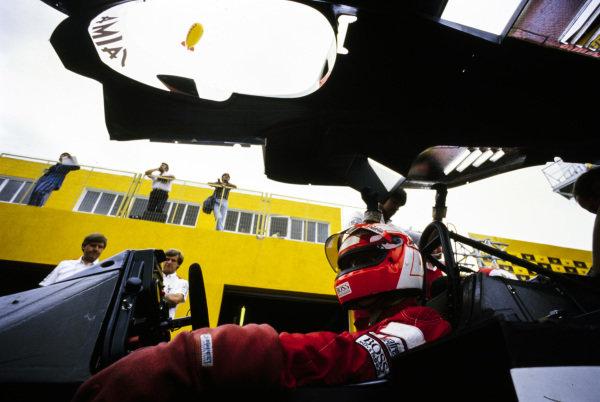 Niki Lauda has the bodywork of his McLaren MP4-2B TAG placed over him. A Pirelli blimp flies over.