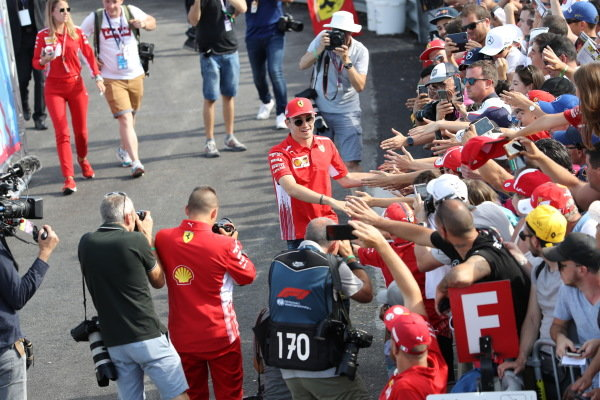 Charles Leclerc greets the fans