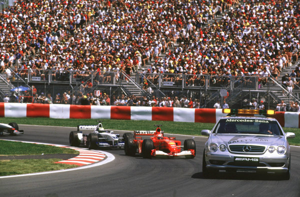 2001 Canadian Grand PrixMontreal, Canada. 8th-10th June 2001The safety car heads Michael Schumacher, Ferrari F2001, and Ralf Schumacher, BMW Williams FW23, afer Juan Pablo Montoya and Rubens Barrichello's accidents halt the race.World Copyright: LAT Photographicref: 35mm Image A16