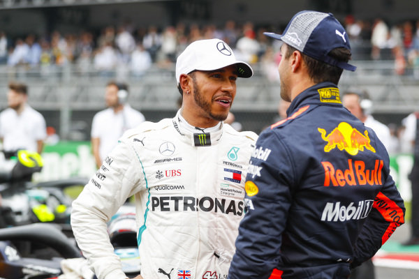 Lewis Hamilton, Mercedes AMG F1, congratulates Daniel Ricciardo, Red Bull Racing, on pole
