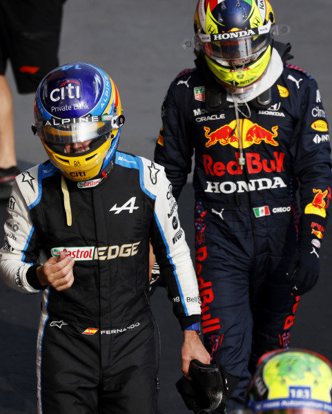 Fernando Alonso, Alpine F1, and Sergio Perez, Red Bull Racing, in Parc Ferme