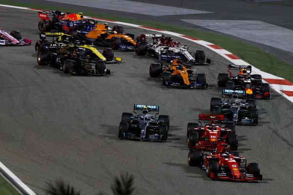 Sebastian Vettel, Ferrari SF90 leads Charles Leclerc, Ferrari SF90 at the start of the race followed by Valtteri Bottas, Mercedes AMG W10 and Lewis Hamilton, Mercedes AMG F1 W10